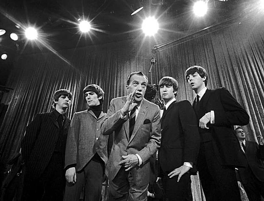 "FILE--Ed Sullivan, center, stands with The Beatles during a rehearsal for the British group's first American appearance, on the ""Ed Sullivan Show,"" in New York on Feb. 9, 1964. From left:  Ringo Starr, George Harrison, Sullivan, John Lennon and Paul McCartney. Harrison, the Beatles' quiet lead guitarist and spiritual explorer died Thursday, Nov. 29, 2001, a longtime family friend told The Associated Press. He was 58. (AP Photo) Photo: Associated Press"