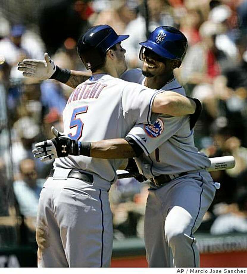 Mets shortstop Jose Reyes, right, hugs teammate David Wright after Reyes' two-run home run off Matt Cain in the fourth inning in San Francisco, Wednesday, June 4, 2008. Photo: Marcio Jose Sanchez, AP