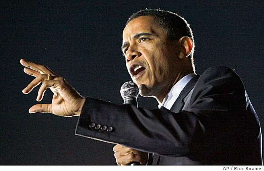 ** FILE * In this Feb. 22, 2008, file photo Democratic presidential hopeful Sen. Barack Obama, D-Ill., campaigns in Austin, Texas. Obama  effectively clinched the Democratic presidential nomination Tuesday, June 3, 2008, based on an Associated Press tally of convention delegates, ahead of the results from the day's final primaries in Montana and South Dakota.  (AP Photo/Rick Bowmer, File) Photo: Rick Bowmer, AP