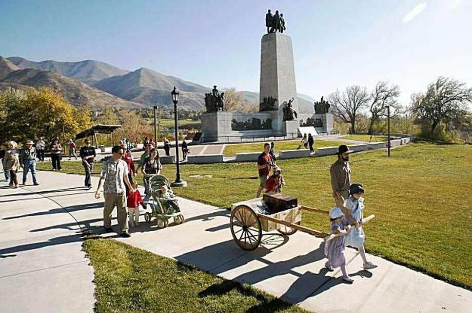 Lucy Danzig, 4, Eliza Danzig, 9, and Peter Danzig pull a replica of a pioneer handcart filled with petitions to Mormon church leaders, Wednesday, Nov. 4, 2009, in Salt Lake City. The Foundation for Reconciliation delivered more than 2,000 petition signatures to The Church of Jesus Christ of Latter-day Saints asking them to reconsider their policies and political activism against same-sex marriage. (AP Photo/The Salt Lake Tribune, Chris Detrick) ** DESERT NEWS OUT, MAGS OUT, NO SALES. ** Photo: Chris Detrick, AP