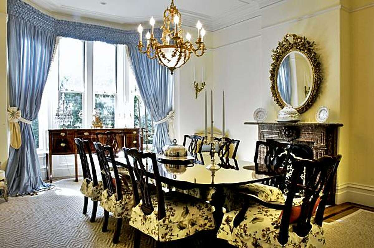 A wide view of the formal dining room, including fireplace, at 1772 Vallejo Street.