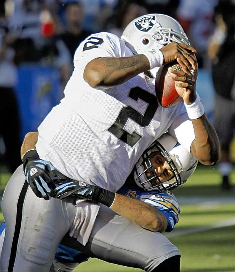 San Diego Chargers' Steve Gregory sacks Oakland Raiders quarterback JaMarcus Russell during the third quarter of an NFL football game Sunday, Nov. 1, 2009 in San Diego.  The Chargers won 24-16.  (AP Photo/Denis Poroy) Photo: Denis Poroy, AP