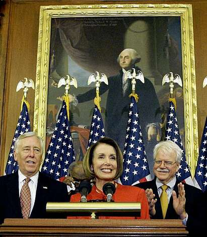 Speaker Nancy Pelosi, center, is joined by (L-R) House Majority Leader Steny Hoyer and Rep. George Miller, D-Calif. during a press conference at the U.S. Capitol, Saturday, Nov. 7, 2009 in Washington after the passage in the house of the health care reform bill. at the U.S. Capitol, Saturday, Nov. 7, 2009 in Washington. (AP Photo/Alex Brandon) Photo: Alex Brandon, AP