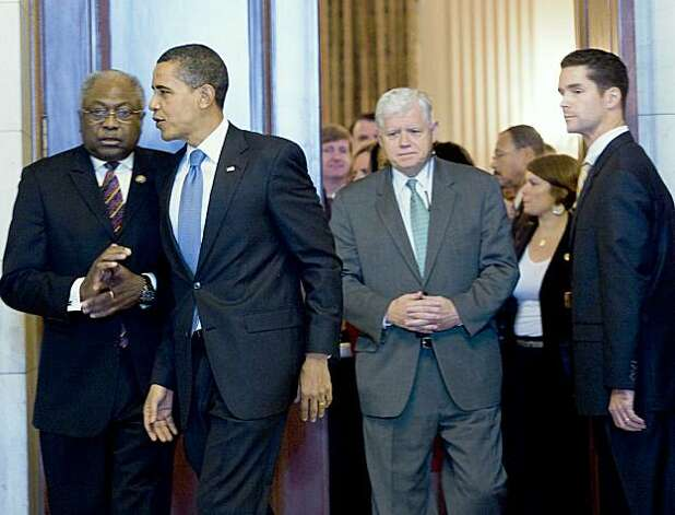 WASHINGTON - NOVEMBER 7:  House Majority Whip James Clyburn (D-SC) (L), President Barack Obama (2L), Rep. John Larson (D-CT) (2R) leave after a caucus meeting on Capitol Hill November 7, 2009 in Washington, DC.  US President Barack Obama spoke with members of the House Democratic Caucus about healthcare reform legislation which is expected to be voted on today.  (Photo by Brendan Smialowski/Getty Images) Photo: Brendan Smialowski, Getty Images
