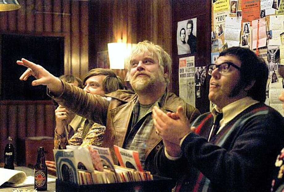 """In this film publicity image released by Focus Features, Philip Seymour Hoffman, center, and Nick Frost, right, are shown in a scene from """"Pirate Radio."""" (AP Photo/Focus features, Alex Bailey) Photo: Alex Bailey, AP"""