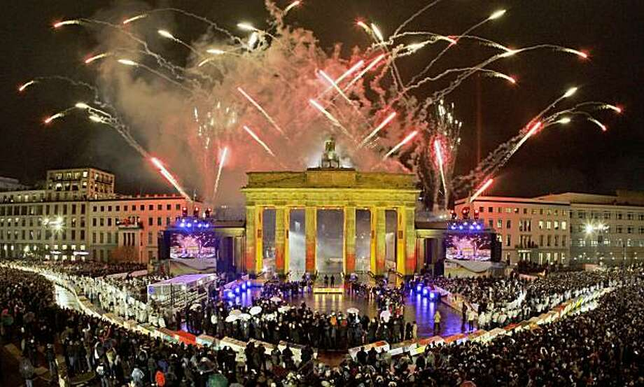 Fireworks illuminate the Brandenburg Gate in Berlin Monday, Nov. 9, 2009, during celebrations marking the 20th anniversary of the fall of the Berlin Wall. (AP Photo/Wolfgang Rattay, pool) Photo: Wolfgang Rattay, AP