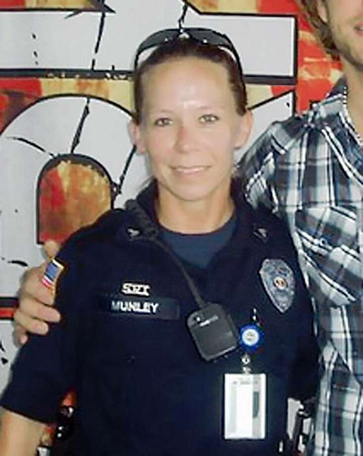 This July 4, 2009 photo obtained Nov. 6, 2009 from the Twitter page of Sgt Kimberly Munley shows Sgt. Munley at Freedom Fest in Frisco, Texas. Officials say 34-year-old Munley ended the shooting spree at Fort Hood on Thursday, Nov. 5 when she shot and wounded alleged shooter Maj. Nidal Malik Hasan. Munley was wounded in the shooting, and was recovering Friday in stable condition. (AP Photo/via Sgt. Munley's Twitter page) NO SALES Photo: AP