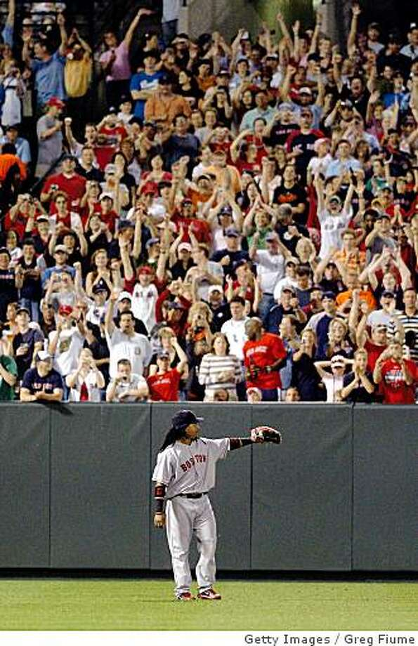 BALTIMORE - MAY 31:  Manny Ramirez #24 of the Boston Red Sox waves to the crowd in left field after hitting his 500th home run in the seventh inning against the Baltimore Orioles May 31, 2008 at Camden Yards in Baltimore, Maryland.  (Photo by Greg Fiume/Getty Images) Photo: Greg Fiume, Getty Images