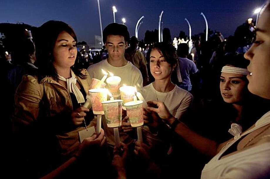 Richmond High School students Jocelyn Campos (left), Rafael Barajas, Janeth Velazquez, Lizeth Franco and Maritza Morales, join together for a candlelight vigil in support for the 15-year-old Richmond High School rape victim. Photo: Michael Macor, The Chronicle