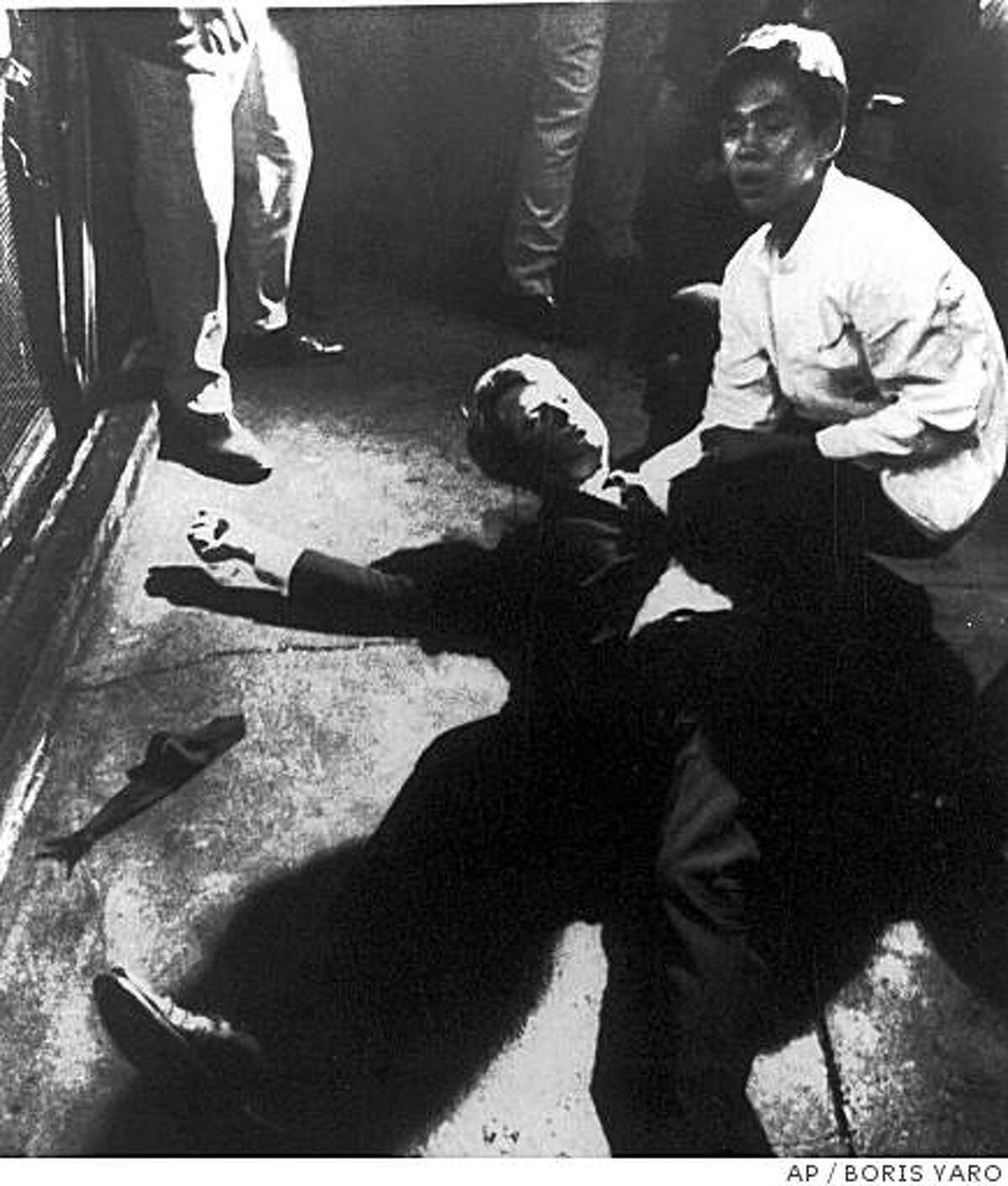 ** FILE ** Sen. Robert Kennedy awaits medical assistance as he lies on the floor of the Ambassador Hotel in this file photo taken June 5, 1968, in Los Angeles moments after he was shot. If all goes as planned, carefully crated pieces of the room where Kennedy was assassinated will be stored on a garbage-strewn lot with a view of graffiti-covered buildings and a strip club billboard. (AP Photo/Los Angeles Times, Boris Yaro, File)