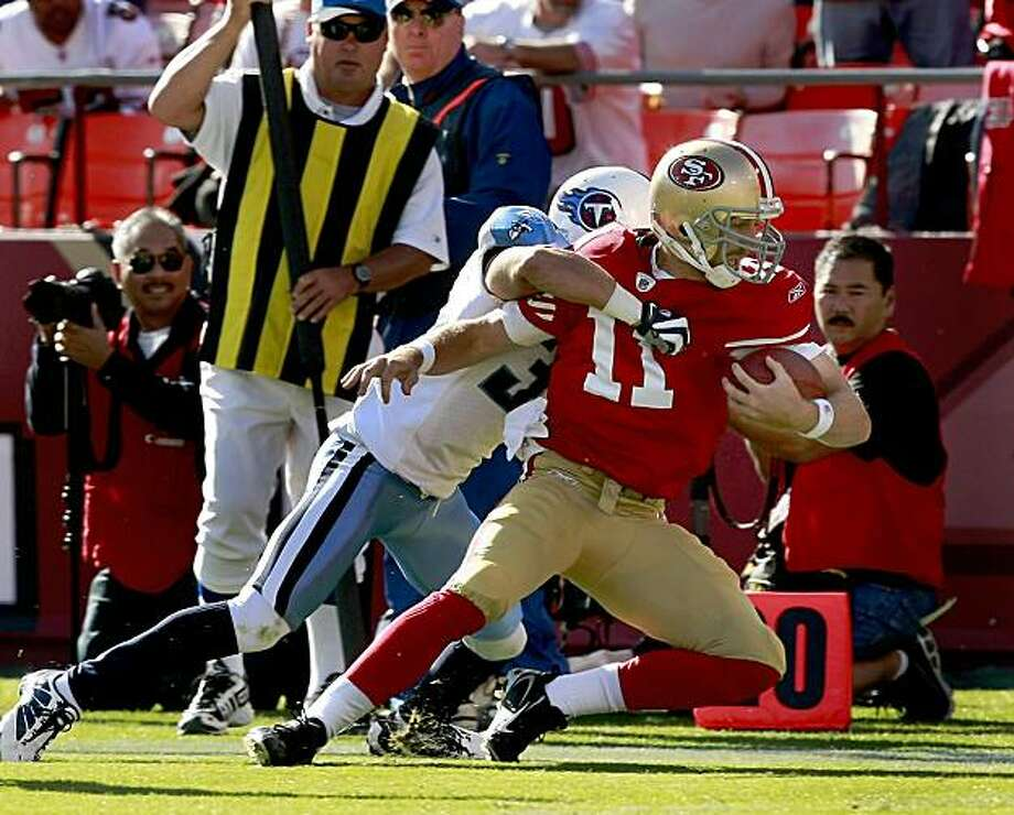 Alex Smith got pulled down by a defender on a sideline scamper in the first half. San Francisco 49ers vs the Tennessee Titans at Candlestick Park Sunday November 8, 2009. The 49ers lost 34-27. Photo: Brant Ward, The Chronicle