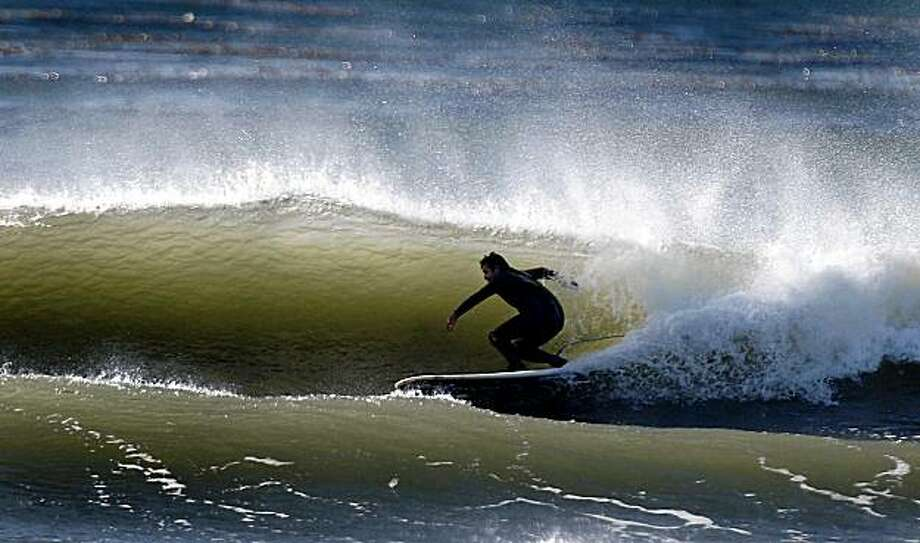 "Legendary surfer Darryl ""Flea"" Virostko rides the waves off Pleasure Point in Santa Cruz, Calif., on Wednesday, Oct. 28, 2009. The three-time Mavericks champion will compete in this year's world class surfing event. Photo: Paul Chinn, The Chronicle"