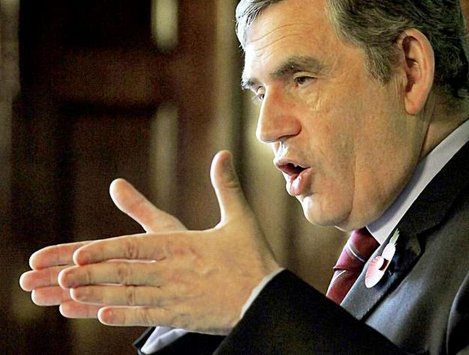 Britain's Prime Minister Gordon Brown delivers a speech to the Royal College of Defence Studies, setting out Britain's position in the on-going war in Afghanistan, Friday Nov. 6, 2009. Brown warned Afghanistan's government to take action against corruption, saying he would not risk more British lives there unless it reforms, and added that success in Afghanistan is vital to Britain's security but declared that if the Afghan government does not mend its ways it will forfeit the world's support. (AP Photo/Oli Scarff/pool) Photo: Oli Scarff, AP