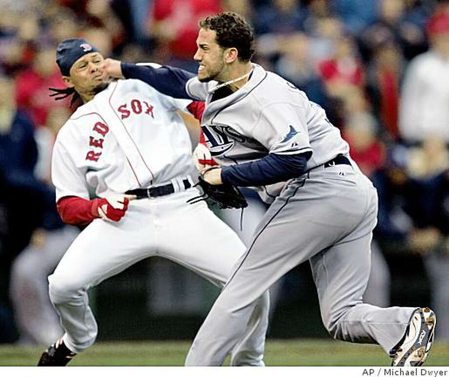 Tampa Bay Rays pitcher James Shields, right, takes a swing at Boston Red Sox's Coco Crisp after Crisp was hit by a pitch and charged the mound in the second inning of a baseball game, Thursday, June 5, 2008, in Boston. (AP Photo/Michael Dwyer) Photo: Michael Dwyer, AP