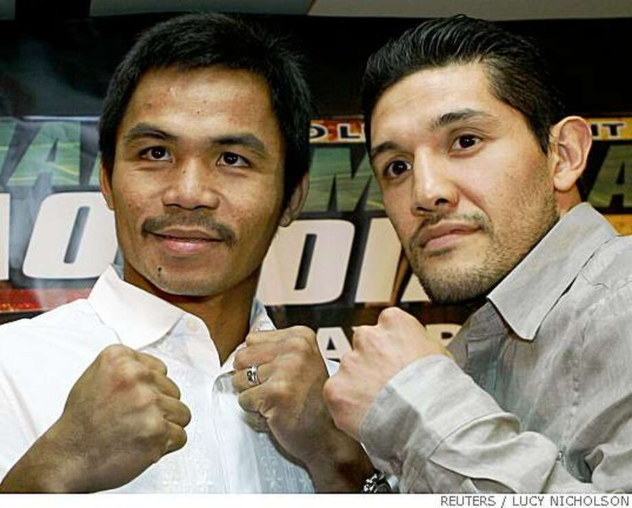 Boxers Manny Pacquiao (L) and David Diaz pose after a news conference to announce their June 28, 2008 WBC World Lightweight Championship bout in Los Angeles May 13, 2008.   REUTERS/Lucy Nicholson  (UNITED STATES) Photo: LUCY NICHOLSON, REUTERS
