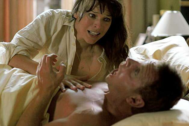 "Dr. Abigail Tyler (MILLA JOVOVICH) attempts to calm her patient (ENZO CLILENTI) in ""The Fourth Kind"", a provocative thriller set in modern-day Nome, Alaska, where--mysteriously since the 1960s--a disproportionate number of the population has been reported missing every year.  Despite multiple FBI investigations of the region, the truth has never been discovered. Photo: Simon Vesrano, Universal Pictures"