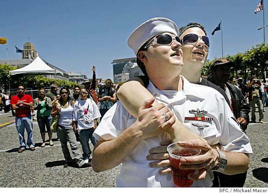 gaypride_077_mac.jpg Partners, Nathan Ellingson, (left) and Gordy Walsh enjoy the entertainment up on stage. LGBT PRIDE CELEBRATION at the Civic Center in San Francisco, Saturday afternoon festivities. Photographed in, San Francisco, Ca, on 6/23/07. Photo by: Michael Macor/ The Chronicle Photo: Michael Macor, SFC