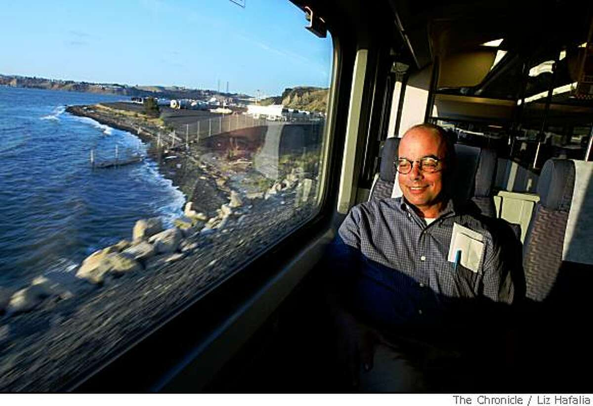 Jeff Magnin, professor from UC Davis, watching the sunset on the bay while riding the Capitol Corridor nearing the Richmond station on Thursday, May 29, 2008. The Chronicle