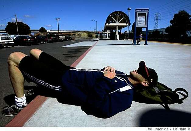 Photographer Dennis Warsen waits for the Capitol Corridor at the Oakland coliseum station commuting to Berkeley, Calif.,  on Thursday, May 29, 2008.  The Chronicle Photo: Liz Hafalia, The Chronicle