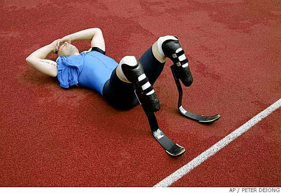 Double-amputee sprinter Oscar Pistorius catches his breath after competing in the 400 meters of the Dutch Open Paralympics event in Emmeloord, Netherlands, Sunday June 1, 2008. The South African wants to qualify for the Beijing Olympics after the Court of Arbitration for Sport ruled that his prosthetic racing blades do not give him an unfair advantage over able-bodied runners. (AP Photo/Peter Dejong) Photo: PETER DEJONG, AP