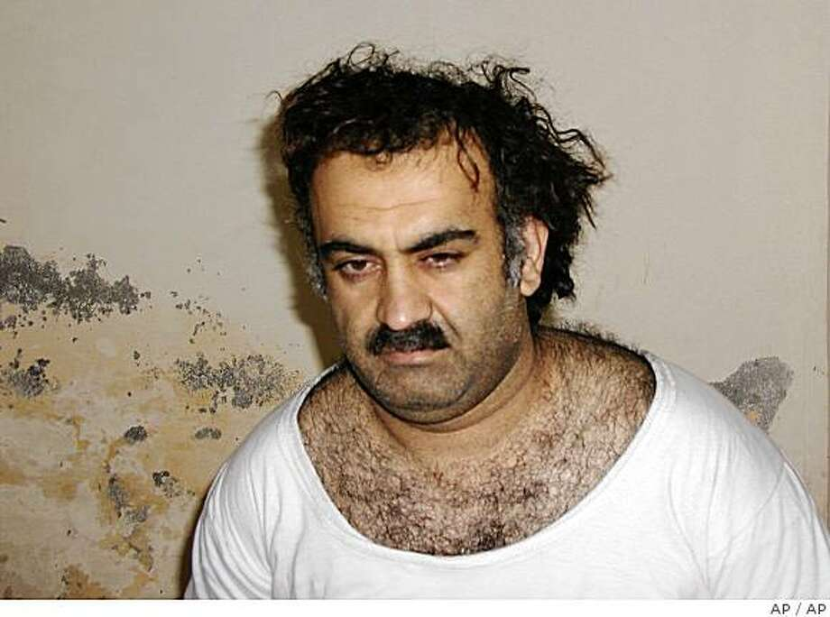 ** FILE ** Khalid Sheikh Mohammed, the alleged Sept. 11 mastermind, is seen shortly after his capture during a raid in Pakistan in this file photo from March 1, 2003 in this photo obtained by the Associated Press. Mohammed, who could face the death penalty for his role in the Sept. 11 attacks, has been peppering his military lawyer with questions in advance of his war crimes trial at Guantanamo, the attorney tells The Associated Press. (AP Photo-File) Photo: AP