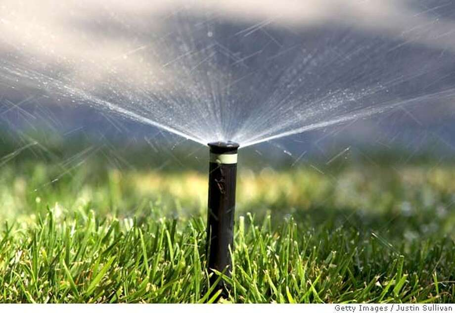 EMERYVILLE, CA - MAY 13:  A sprinkler waters a lawn  May 13, 2008 in Emeryville, California. Residents of the Northern California counties of Contra Costa and Alameda may be forced to cut their water useage between 20 and 30 percent if the East Bay Municipal Utility District declares a water shortage emergency as water is in short supply after two years of dry weather and the driest spring on record this year. East Bay Municipal Utility District serves nearly 1.3 million customers in the East Bay region of the San Francisco Bay Area.  (Photo by Justin Sullivan/Getty Images) Photo: Getty Images