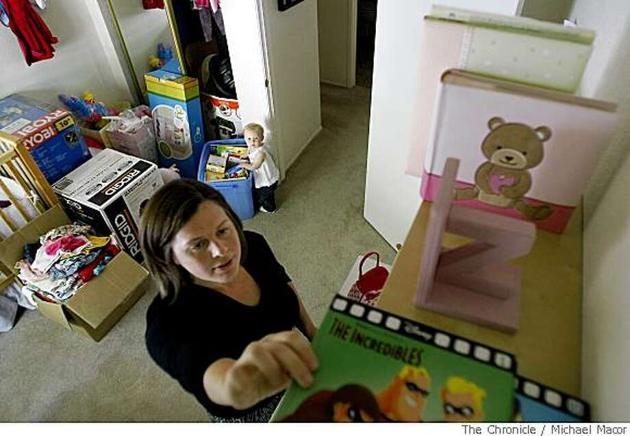 Jen Deir, and her one-year-old daughter, Zoe, pack her daughter's room in their Benicia apartment. Photo: Michael Macor, The Chronicle