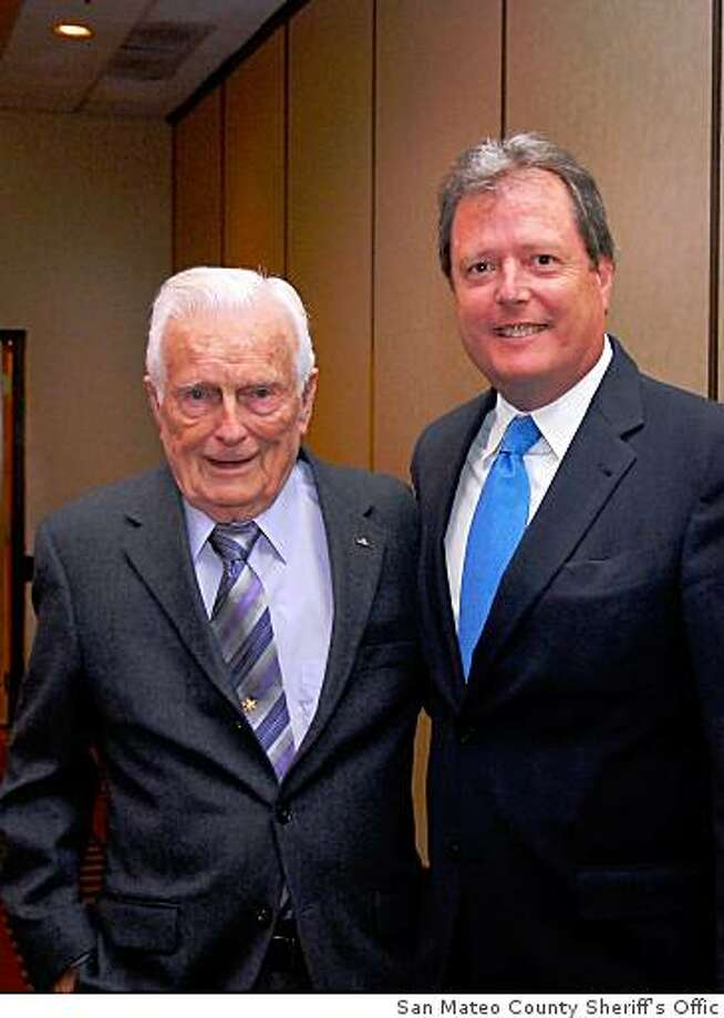Former San Mateo County Sheriff Earl Whitmore, 90, at left at a sheriff's association dinner in May.  Whitmore is joined by current Sheriff Greg Munks. (Provided by the San Mateo County Sheriff's Office) Photo: San Mateo County Sheriff's Offic