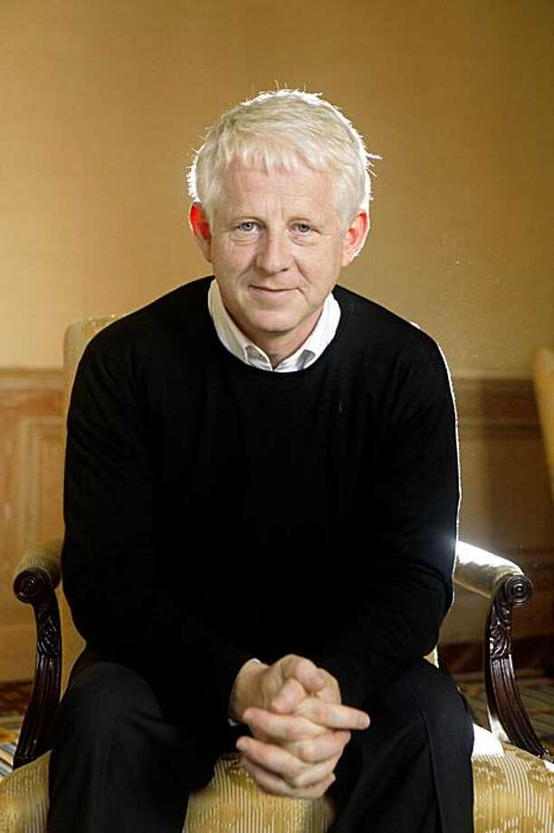 "Richard Curtis, film director who has a new movie called ""PIRATE RADIO,"" sits for a portrait on Wednesday Oct. 21, 2009 in San Francisco, Calif. Photo: Mike Kepka, The Chronicle"