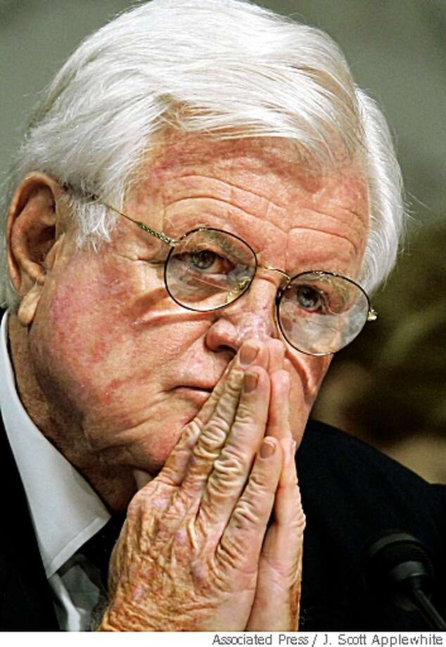Sen. Edward Kennedy, D-Mass., listens intently to chief justice nominee John Roberts during his Senate Judiciary confirmation hearing on Capitol Hill in Washington in 2005.  Associated Press photo by J.Scott Applewhite Photo: J. Scott Applewhite, Associated Press