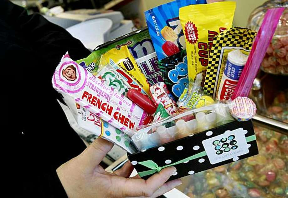 """The Candy Store owner Diane Campbell holds a popular candy assortment called """"Blast from the Past."""" Despite a bad economy, people are still buying candy. Places like The Candy Store on Vallejo Street in San Francisco are still getting plenty of in-store and internet sales and expect Halloween business to be robust. Photo: Brant Ward, The Chronicle"""
