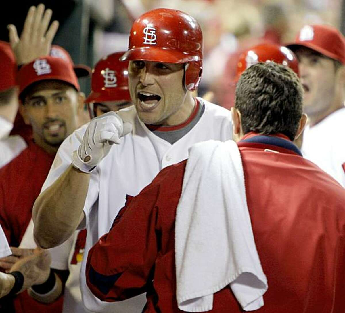 St. Louis Cardinals' Matt Holliday celebrates is congratulated by teammates after he hit a three-run home run during the seventh inning of a baseball game against the Milwaukee Brewers on Tuesday, Sept. 1, 2009, in St. Louis. (AP Photo/Jeff Roberson)