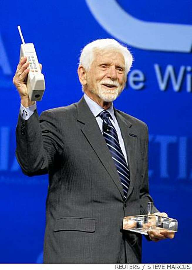 Martin Cooper holds a replica of the first cellular phone at CTIA Wireless 2008 in Las Vegas, Nevada April 2, 2008. Martin, a general manager of Motorola's Communications Systems Division at the time, is credited with making the first public telephone call placed on a portable cellular phone on April 3, 1973. REUTERS/Steve Marcus (UNITED STATES) Photo: STEVE MARCUS, REUTERS
