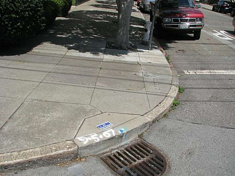 This curb at Vallejo and Laguna streets in San Francisco is not wheelchair friendly. Photo: Jonathan Curiel