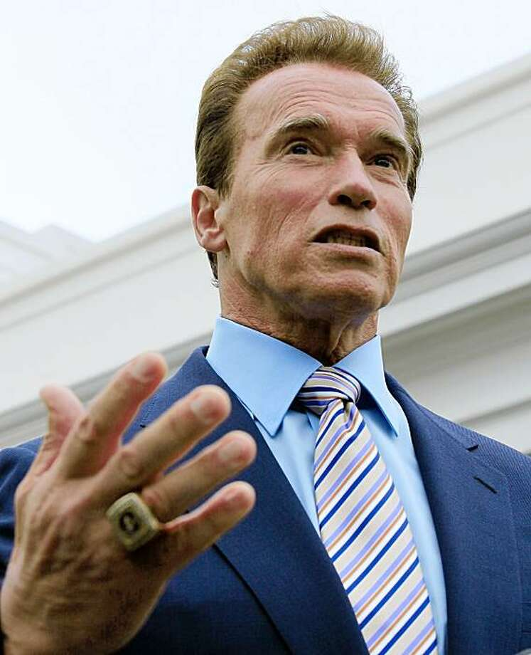 WASHINGTON - OCTOBER 30:  Governor Arnold Schwarzenegger (R-CA) speaks to reporters after a meeting with Vice President Joseph Biden at the White house on October 30, 2009 in Washington, DC. Earlier Governor Schwarzenegger participated in an event with Vice President Biden on jobs saved by the American Recovery and Reinvestment Act.  (Photo by Mark Wilson/Getty Images) Photo: Mark Wilson, Getty Images