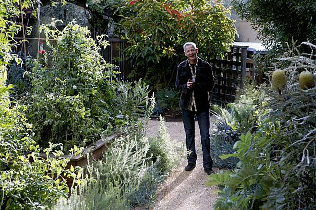 Landscape designer, Bernadro Lopez shows off his latest creation at Michael Pollan's home on Tuesday, Oct. 27, 2009 in Berkeley, Calif.