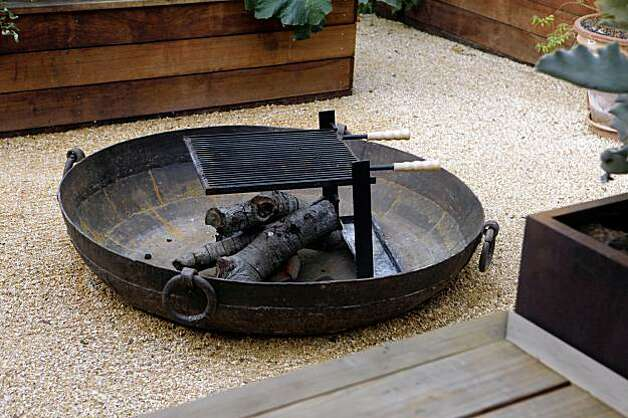 A fire pit is showcased in Landscape designer, Bernadro Lopez's latest creation at Michael Pollan's home on Tuesday, Oct. 27, 2009 in Berkeley, Calif. Photo: Mike Kepka, The Chronicle