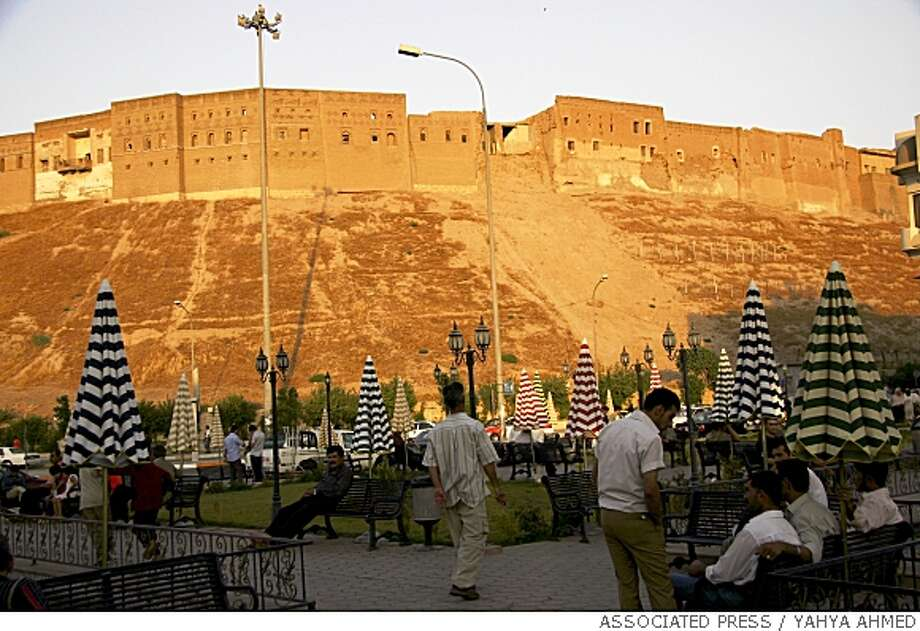 An ancient castle towers above a park in Irbil, a city in the Kurdish controlled north 350 kilometers (217 miles) north of Baghdad, Iraq on Tuesday, Sept. 18, 2007. In nation defined by war, Kurdistan's capital, Irbil, resembles a city at peace, at least by Iraqi standards. (AP Photo/Yahya Ahmed) Photo: YAHYA AHMED, ASSOCIATED PRESS