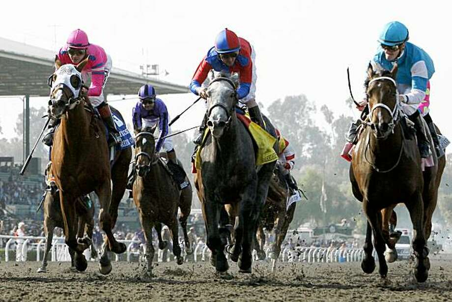 She Be Wild, right, ridden by Julien Leparoux, beats, Beautician, center, ridden by Robby Albarado and Blind Luck, left, ridden by Tyler Base at the Breeders' Cup Juvenile Fillies horse race at Santa Anita Park, Friday, Nov. 6, 2009, in Arcadia, Calif. (AP Photo/Mark J. Terrill) Photo: Mark J. Terrill, AP