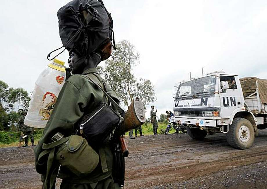 (FILES) This file picture taken on December 10, 2008 of a Congolese army soldier standing by a truck of the United Nations Mission in Democratic Republic of Congo (MONUC) near the frontline in the vicinity of the eastern Democratic Republic of Congo (DRC) town of Kibati in the North Kivu region. On November 2, 2009 the UN's peace keeping operation, MONUC, announced the suspension of logistic support to the army unit of the Democratic Republic of Congo implicated in the killings of 62 civilians between May and September 2009. AFP PHOTO / PASCAL GUYOT (Photo credit should read PASCAL GUYOT/AFP/Getty Images) Photo: Pascal Guyot, AFP/Getty Images