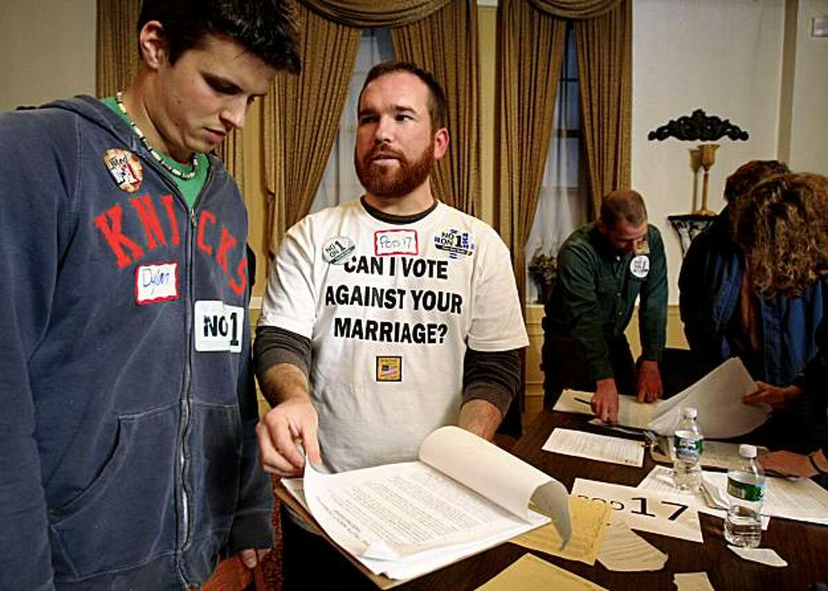 Hugh Tims, second from left, of Portland, Maine, gives instructions to canvassers before going out in support of same-sex marriage, Tuesday, Nov. 3, 2009, in Portland, Maine. Voters will decide Question 1, the proposal to rescind the Legislature's approval of same-sex marriage.
