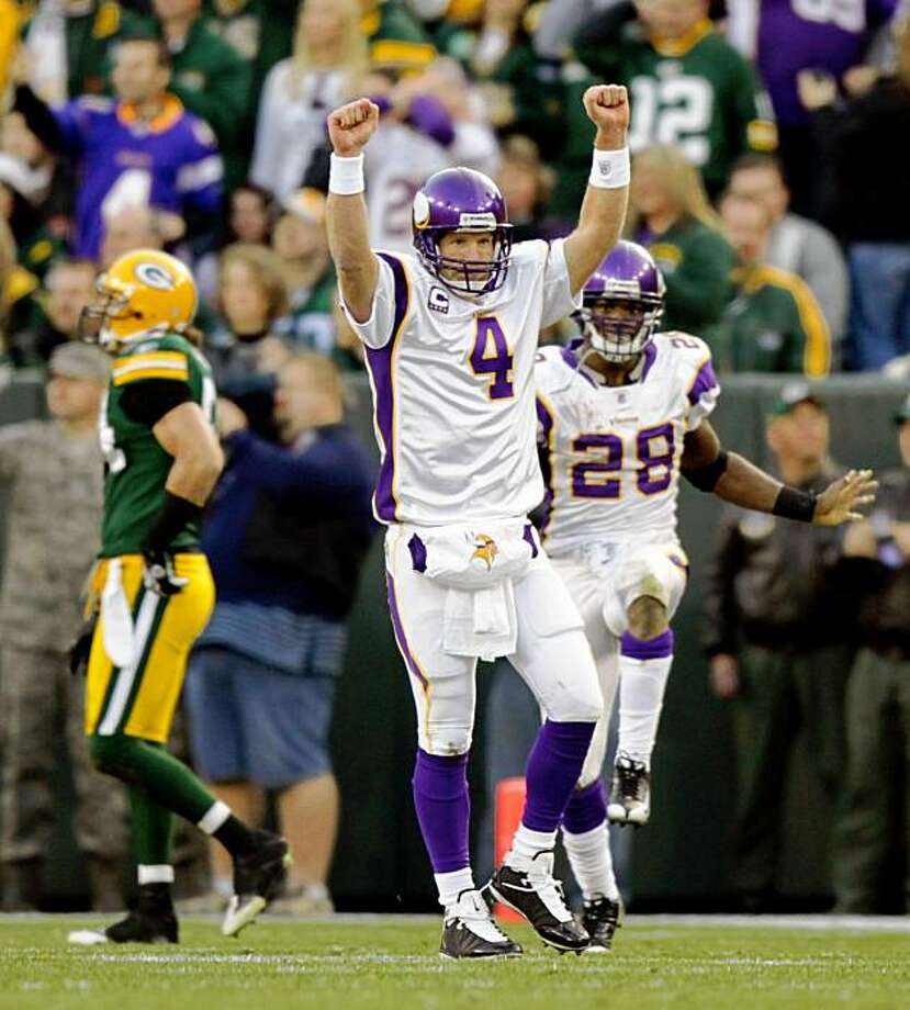 Minnesota Vikings quarterback Brett Favre (4) and running back Adrian Peterson celebrate a Vikings touchdown during the second quarter of an NFL football game against the Green Bay Packers on Sunday, Nov. 1, 2009, in Green Bay, Wis. (AP Photo/Star Tribune, Brian Peterson) ** ST. PAUL OUT  MINNEAPOLIS-AREA TV OUT  MAGS OUT ** Photo: Brian Peterson, AP