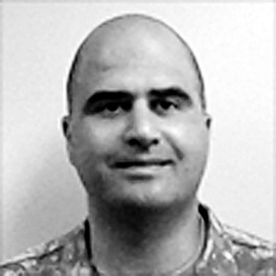 UNDATED:  (EDITORIAL USE ONLY; NO SALES; NO ARCHIVE) In this undated handout photo from the website of the U.S. Government Uniformed Services University of the Health Sciences downloaded on November 5, 2009, Maj. Nidal Hasan, the U.S. Army doctor named as a suspect in the shooting death of at least 11 people and wounding of 31 others at Fort Hood, Texas November 5, is pictured. Photo: Handout, Getty Images