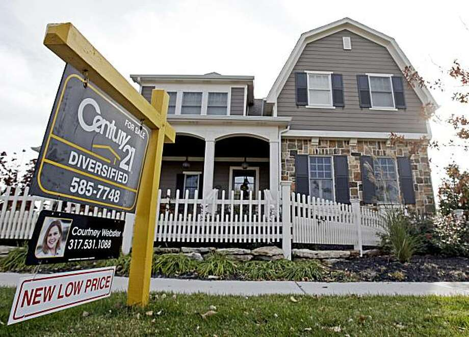 FILE - In this Oct. 20, 2009 file photo, a home with a reduced price for sale in Carmel, Ind. neighborhood is shown.  Buying a home is about to get cheaper for a whole new crop of homebuyers _ $6,500 cheaper.(AP Photo/Michael Conroy, file) Photo: Michael Conroy, AP