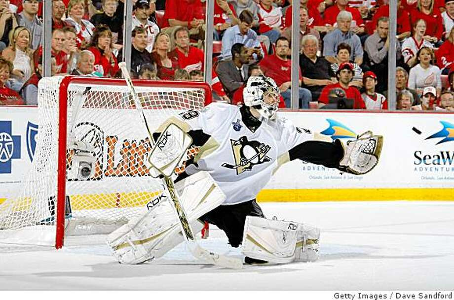 DETROIT - JUNE 02:  Goaltender Marc-Andre Fleury #29 of the Pittsburgh Penguins makes a save on a shot from the Detroit Red Wings during game five of the 2008 NHL Stanley Cup Finals at Joe Louis Arena on June 2, 2008 in Detroit, Michigan.  (Photo by Dave Sandford/Getty Images) Photo: Getty Images