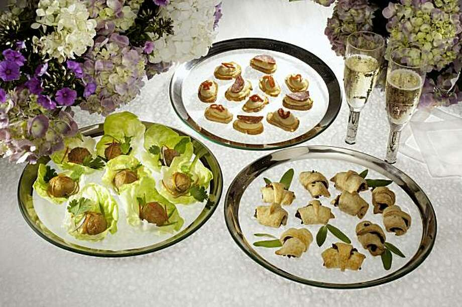 Holiday party food in San Francisco, Calif., on October 23, 2009. Lettuce Wrapped Vietnamese Meatballs, Crustini with White Bean Puree, and Mushroom Puff Pastry. Food styled by Amanda Gold, Rachael Daylong and Rose Amoroso. Photo: Craig Lee, Special To The Chronicle