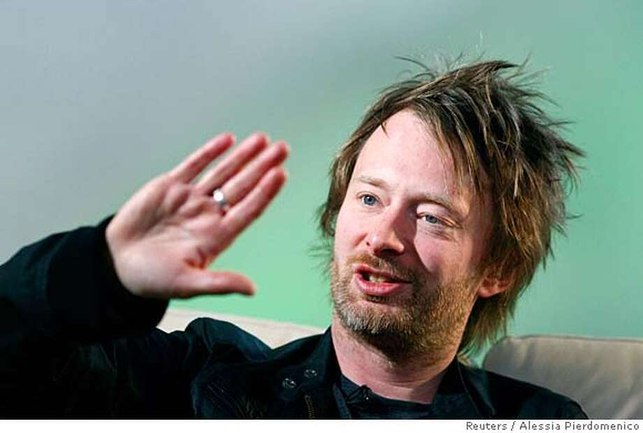 ###Live Caption:Radiohead's Thom Yorke gestures during an interview with Reuters in Maidenhead, central England, April 23, 2008. Pioneering British rock band Radiohead has lent one of its songs to an MTV campaign to raise awareness about sweatshop labour and human trafficking. Photograph taken April 23, 2008. REUTERS/Alessia Pierdomenico (BRITAIN)###Caption History:Radiohead's Thom Yorke gestures during an interview with Reuters in Maidenhead, central England, April 23, 2008. Pioneering British rock band Radiohead has lent one of its songs to an MTV campaign to raise awareness about sweatshop labour and human trafficking. Photograph taken April 23, 2008. REUTERS/Alessia Pierdomenico (BRITAIN)###Notes:Radiohead's Thom Yorke gestures during an interview with Reuters in Maidenhead, central England###Special Instructions: Photo: ALESSIA PIERDOMENICO