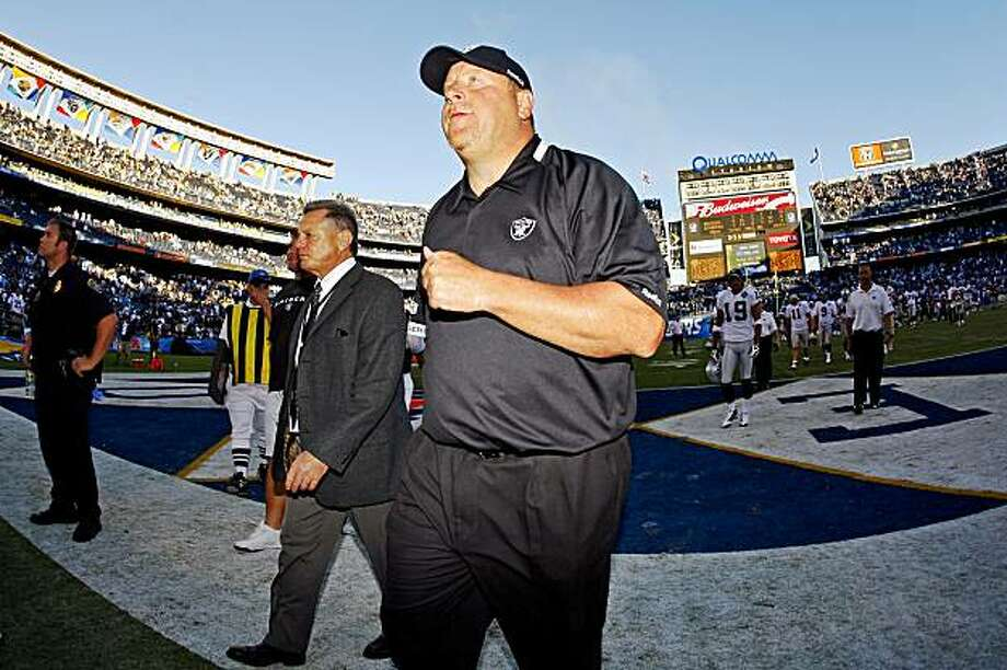 Oakland Raiders head coach Tom Cable leaves the field after his team lost to the San Diego Chargers 24-16 in an NFL football game Sunday, Nov. 1, 2009 in San Diego. (AP Photo/Chris Park) Photo: Chris Park, AP