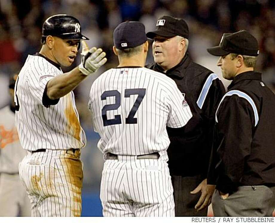 New York Yankees batter Alex Rodriguez (L) and manager Joe Girardi (27) appeal to umpires Tim Welke and Chris Guccione (R) after Rodriguez hit a ball that appeared to be a home run against the Baltimore Orioles in the sixth inning of their MLB American League baseball game at Yankee Stadium in New York, May 21, 2008. The umpires ruled the hit was a double.  REUTERS/Ray Stubblebine  (UNITED STATES) Photo: RAY STUBBLEBINE, REUTERS