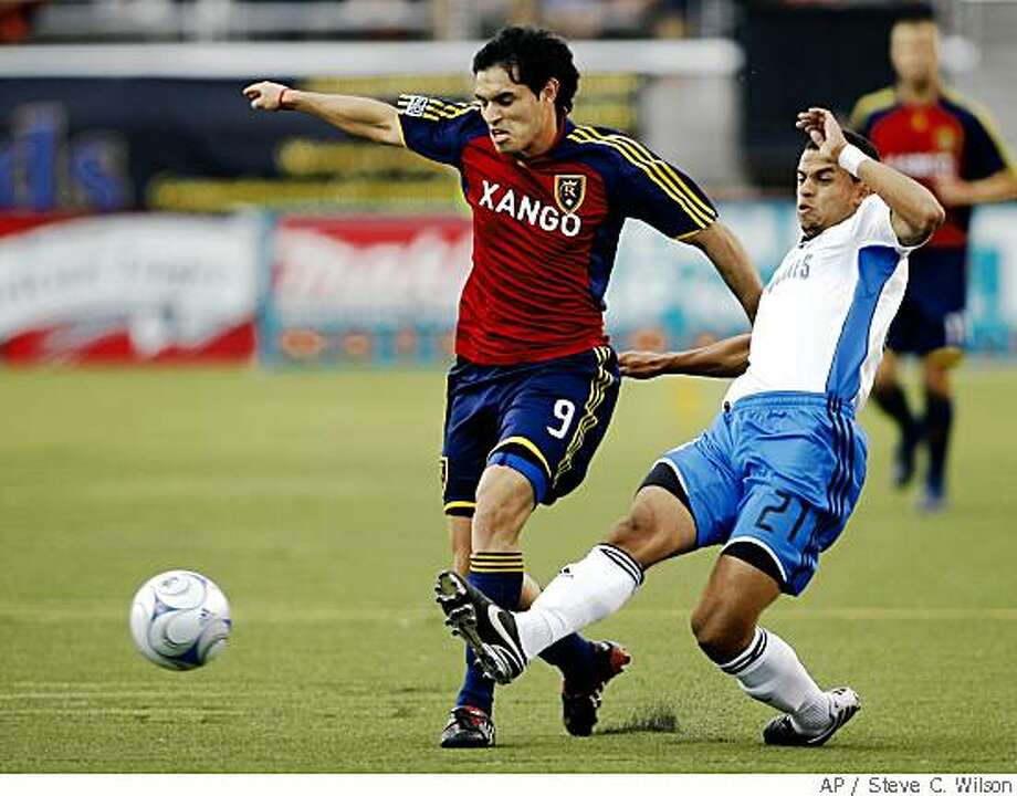 San Jose Earthquakes defender Jason Hernandez, right, kicks the ball away from Real Salt Lake forward Fabian Espindola, left, during first half of an MLS game on Saturday, May 31, 2008 in Salt Lake City. The Associated Press photo by Steve C. Wilson Photo: Steve C. Wilson, AP